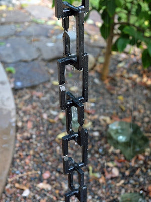 Black Rectangle Links Rain Chain with flowing rain water in garden