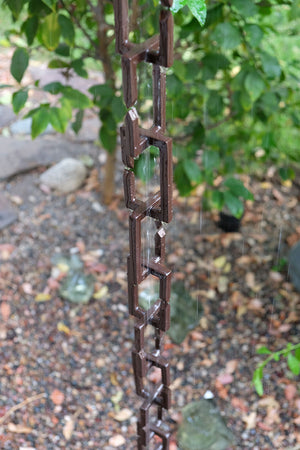 Rectangle Links Rain Chain with flowing rain water in garden