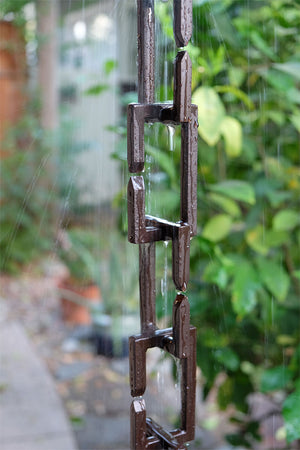 Bronze Rectangle Links Rain Chain with flowing rain water