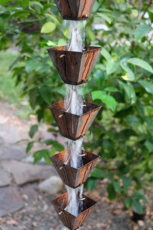 Aged Medium Square Cups Rain Chain with water flowing through cups