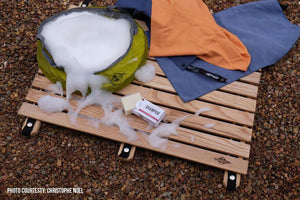 wooden landing pad being used for outdoor shower with camp soap and shower