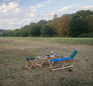 The Wooden and portable Voyager Table used for picnic in field