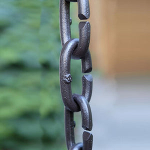 Closeup of Cast Oval Links Rain Chain in bronze