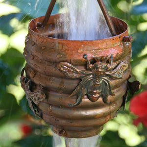 Honeybee & Hive Copper Rain Chain with water flowing through cup
