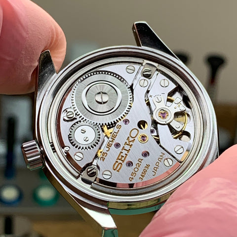 Servicing a Seiko 4502-7001 and a discussion of the hack stop and quick date change mechanisms