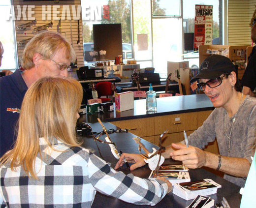 Steve Vai Signs Mini Guitar Collectibles by AXE HEAVEN