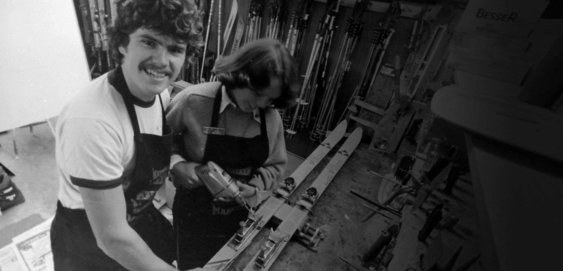 Vintage image of Skiis and Biikes founders tuning skis