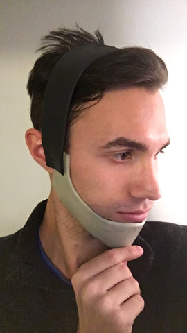 Crimsyn Cosplay wearing the chin strap with his thumb on the chin strap