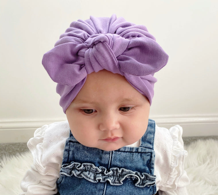Purple baby hat with bow