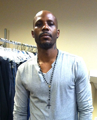 DMX wearing Rosary Black Diamond Earrings