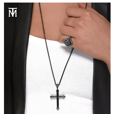 Woman wearing diamond ring and cross pendant by Mander Jewelry