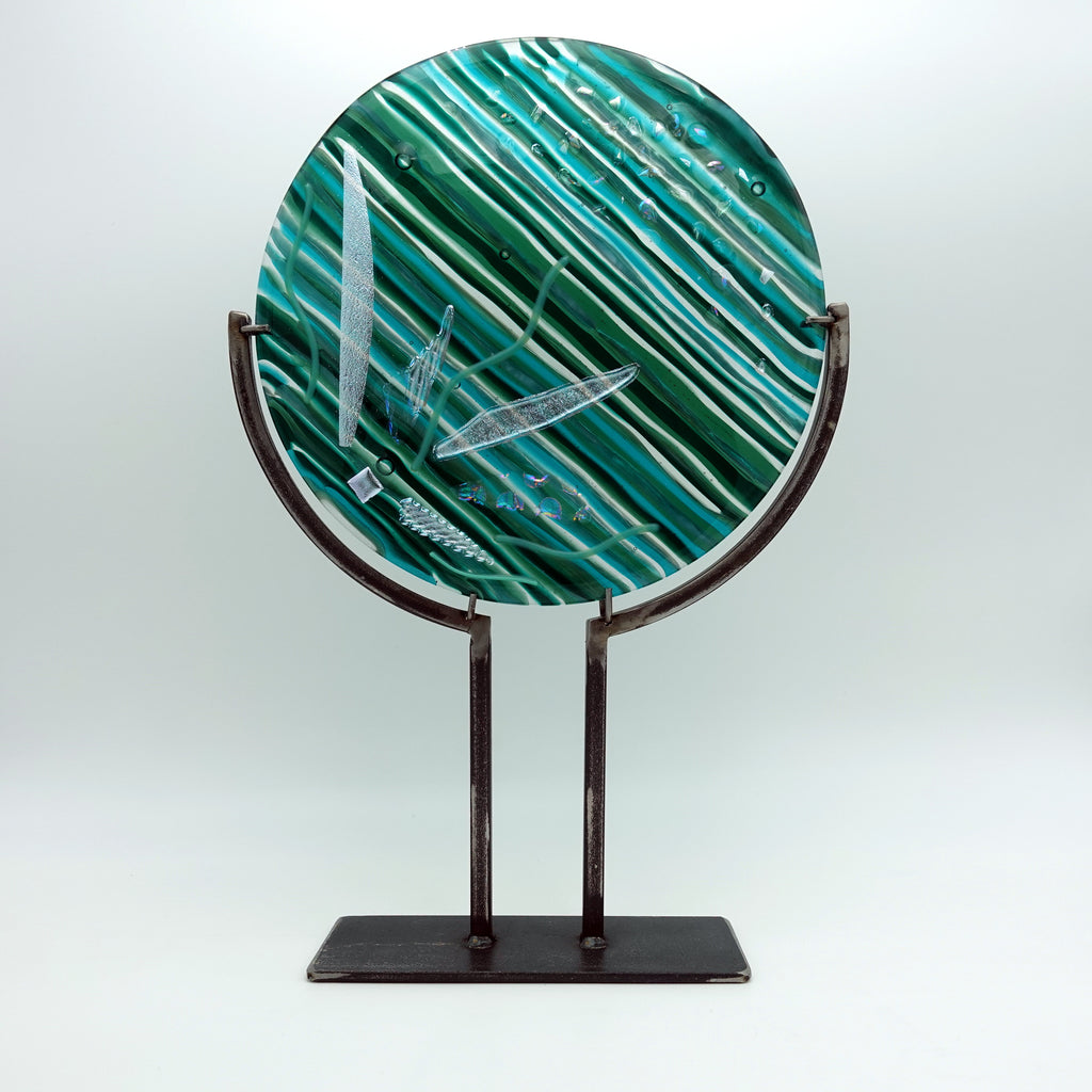 "Linear shades of green with dichroic accents (10"" diameter)"