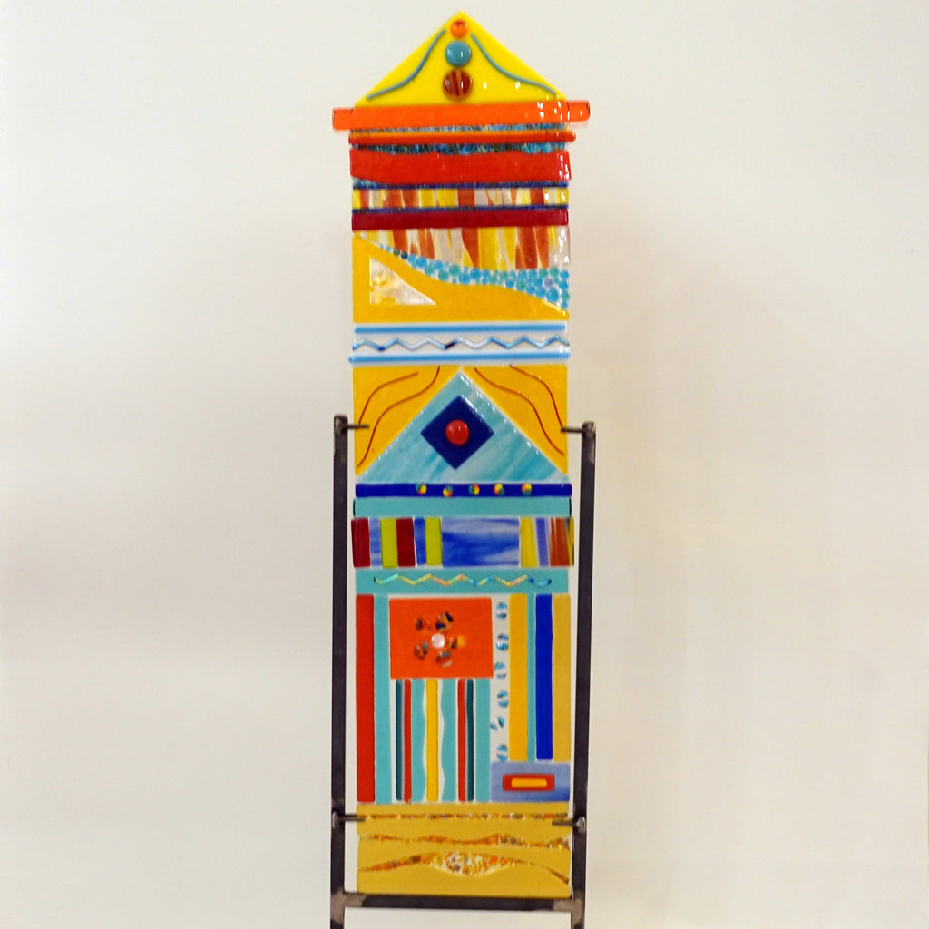Large totem, pinnacle top with orange turquoise dots and stand