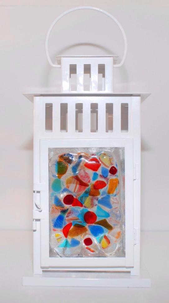 12 inch white metal lantern with four multi color fused glass panels