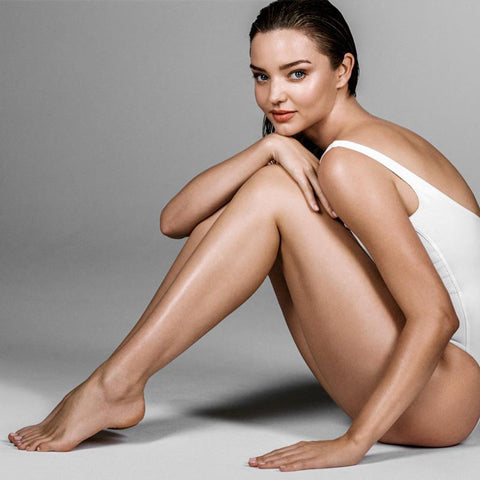 Miranda Kerr with Gradual Self Tanning Lotion