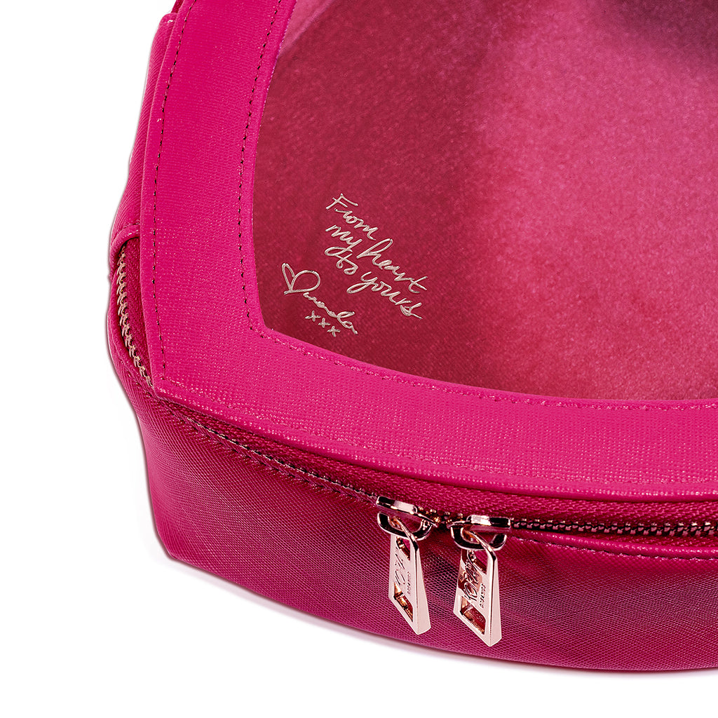 The Love Beauty Bag also includes a love note from Miranda, embossed on the front window.