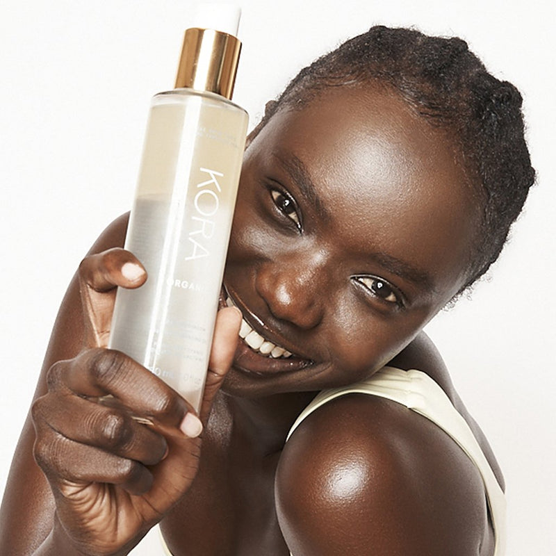 A woman with Milky Mushroom Gentle Cleansing Oil. Cleanse and nourish with this CLEAN BEAUTY, Certified Organic nourishing dual-phase cleansing milk that gently and thoroughly removes dirt, oil and makeup.