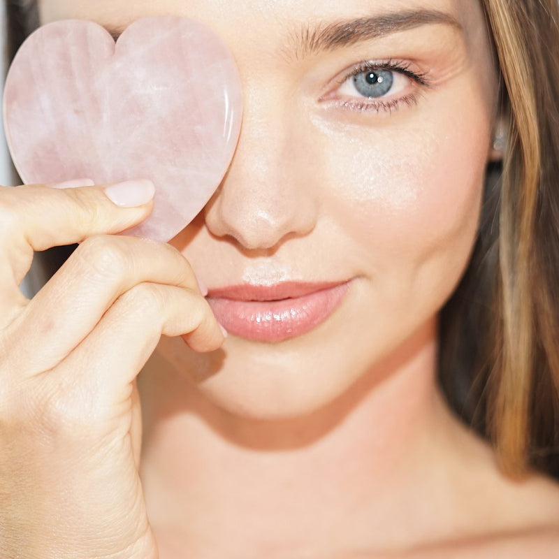 """I wake up with a puffy face most mornings, so I wanted to create a tool that could quickly help stimulate circulation and reduce puffiness. I love to use this together with my Noni Glow Face Oil – it helps the oil absorb deeper into the skin while also increasing blood flow and promoting collagen production. I'm obsessed!"" – Miranda Kerr, Founder & CEO of KORA Organics"