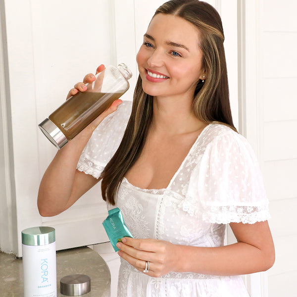 Miranda Kerr drinking Noni Glow Skinfood Supplement with Prebiotics in Self-Love Rose Quartz Glass Water Bottle