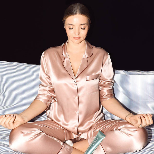Miranda taking a moment for her self and meditating with the Noni Glow Sleeping Mask