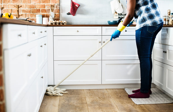 cleaning up kitchen with a mop