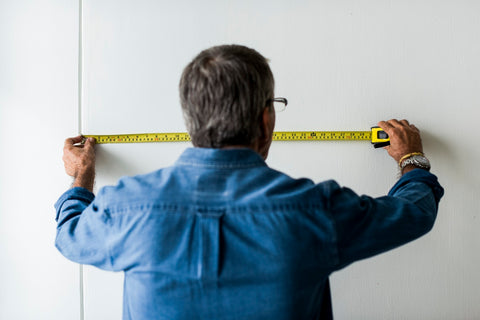 DIY man with tape measure do it yourself
