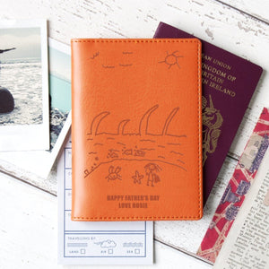 Orange passport wallet with child's drawing