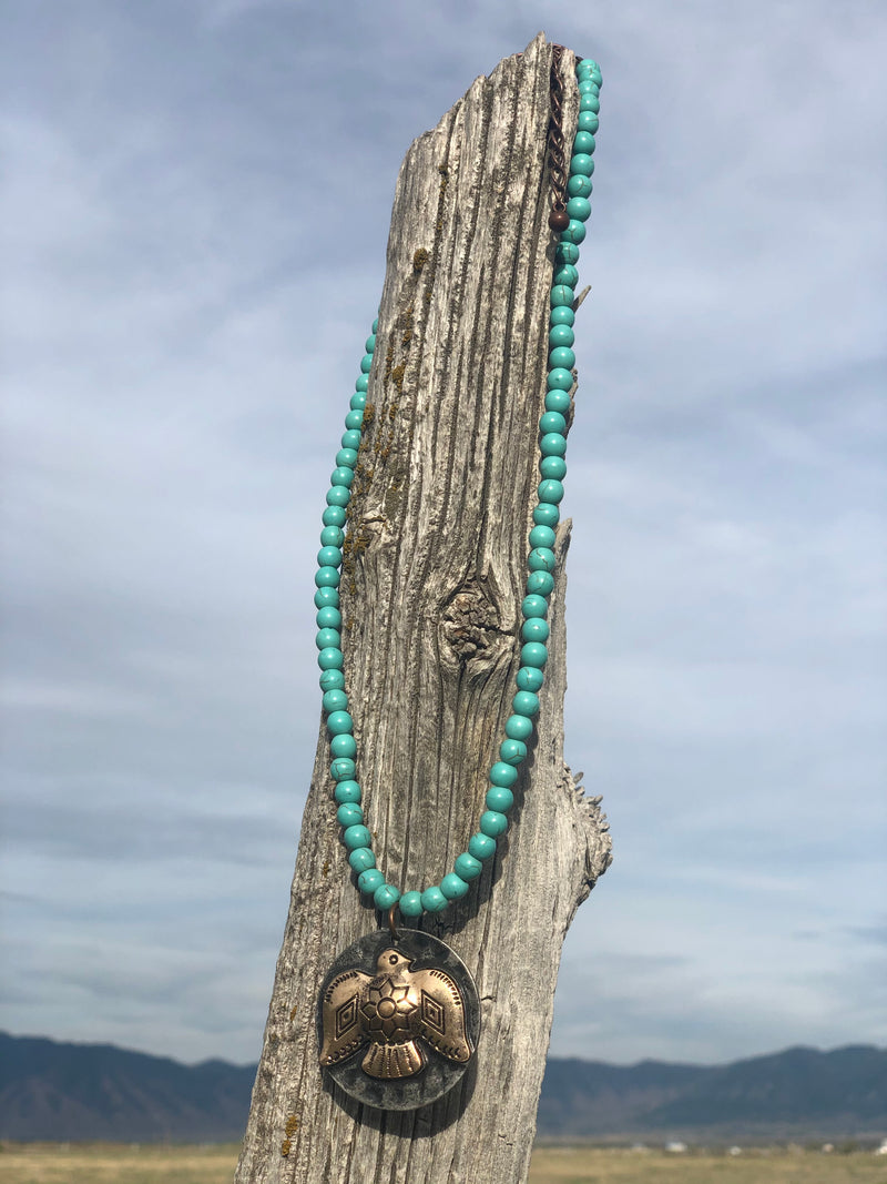 The Thunderbird Pendant Turquoise Bead Necklace