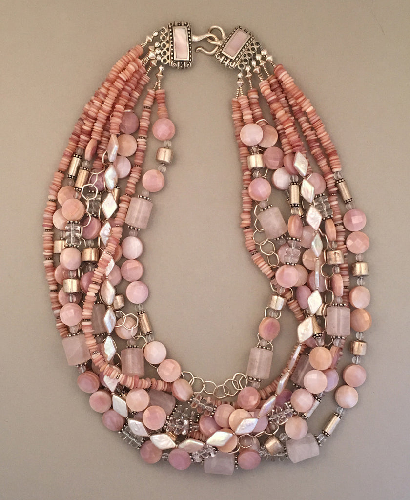 Multi-strand mother of pearl and sterling silver statement necklace.  Handcrafted, one-of-a-kind.