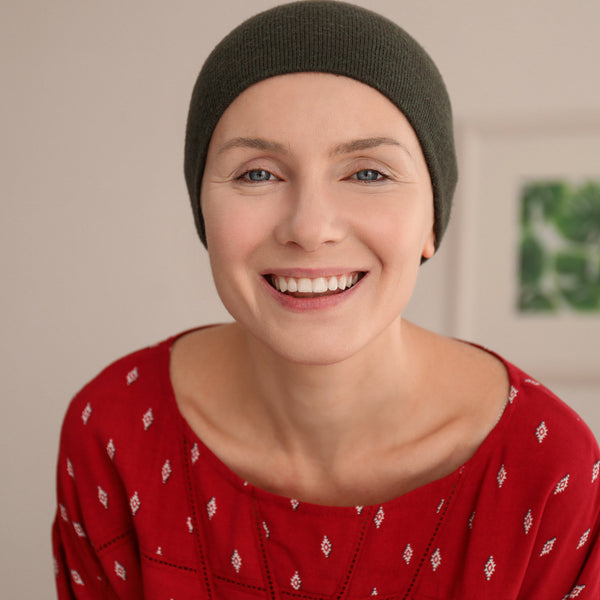 Bald Woman wearing Hat
