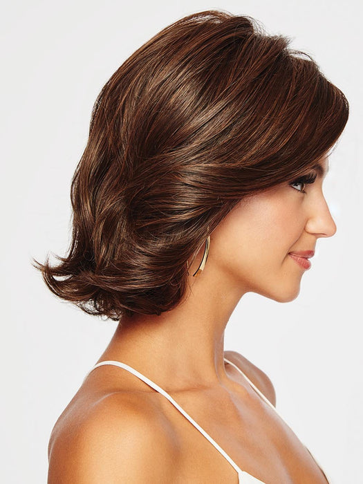 CROWD PLEASER has dramatic side swept bangs and long, subtle layering throughout.