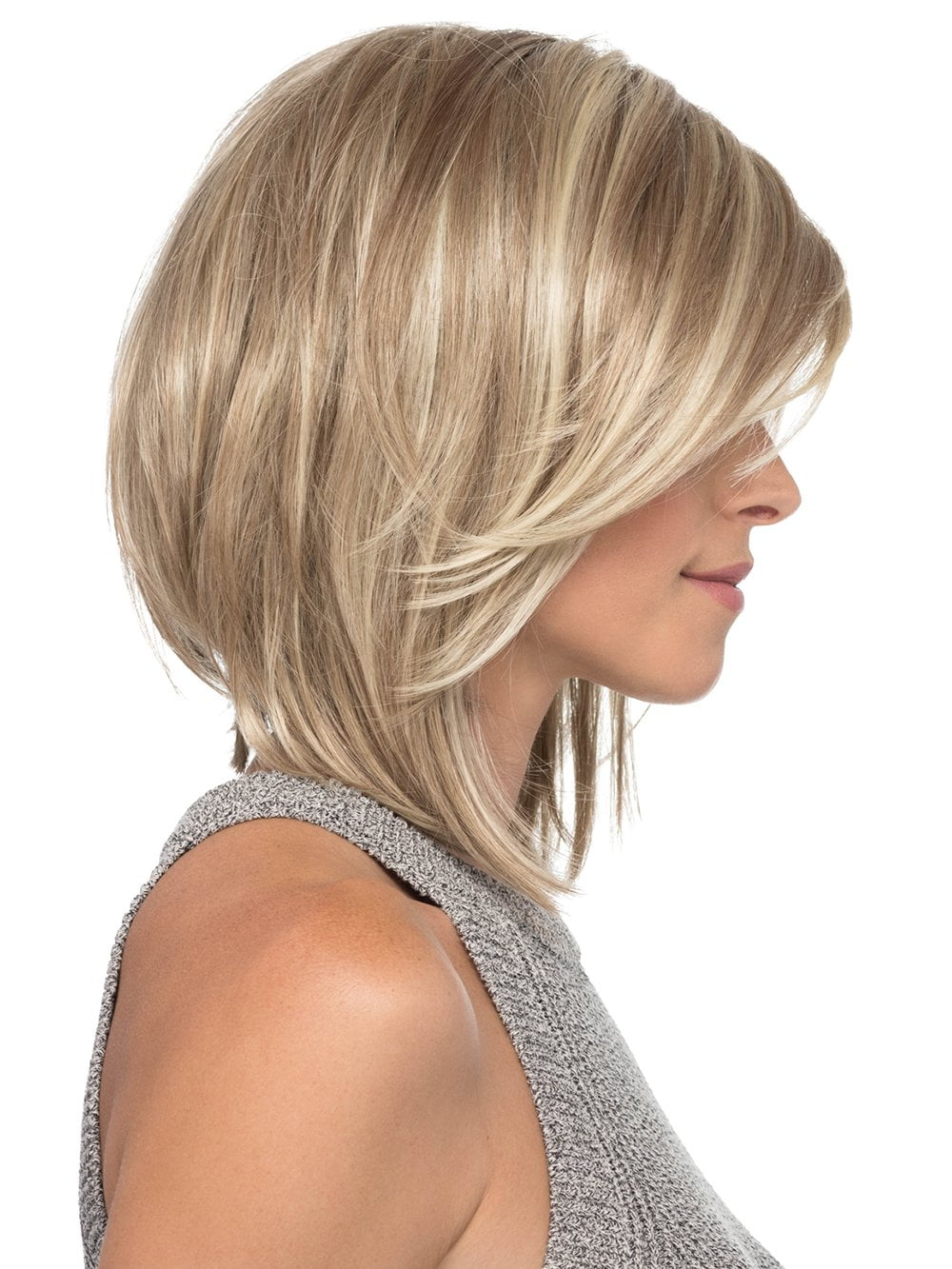 Her slightly angled layers and flowing side bangs make this shoulder length style simple and sleek for a perfect evening