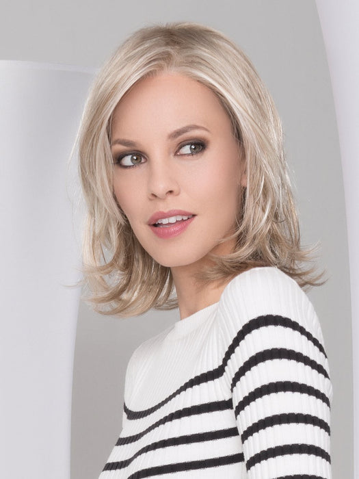 Styling versatility is made possible with the art of Ellen Wille's beautifully crafted monofilament top and lace front