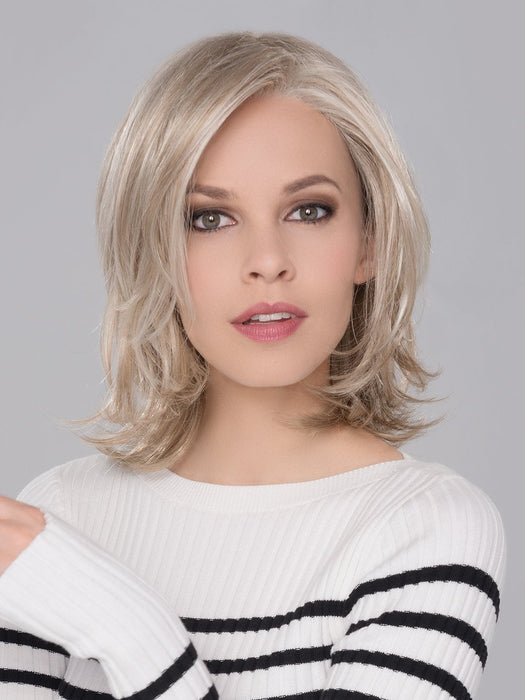 The density of the ready-to-wear synthetic hair mimics the look and feel of biological hair and requires little to no customization or thinning