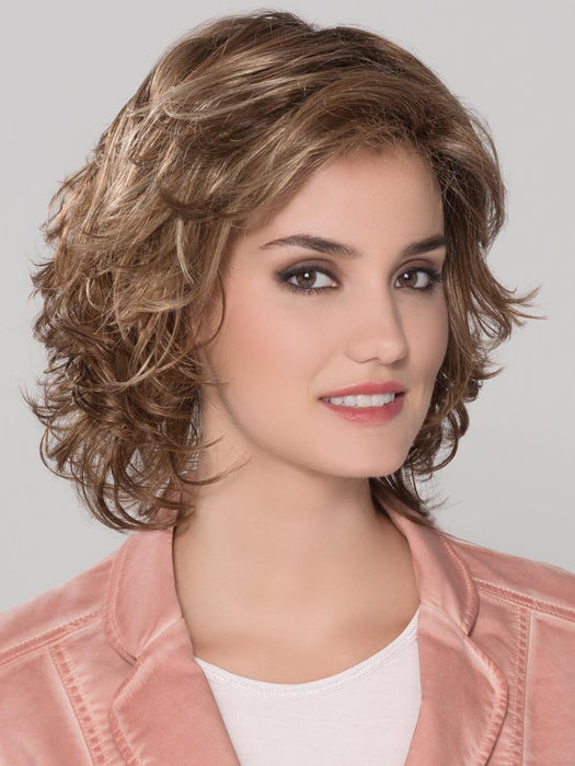 A shoulder length style full of soft waves all over, and a wispy bang