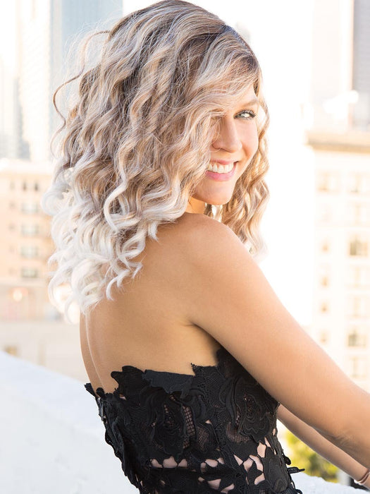 A youthful fun style that features long, playful spiral curls