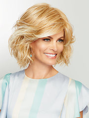 Cropped to nape bob that is packed with fullness and curl.