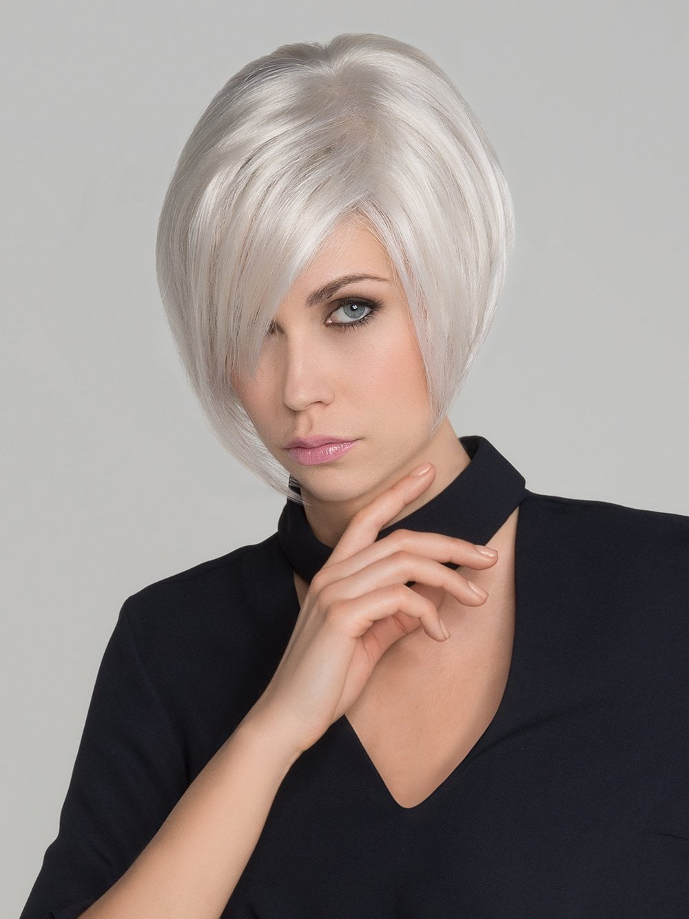 A lightweight asymmetrical lace front wig with a long fringe that falls perfectly along the face