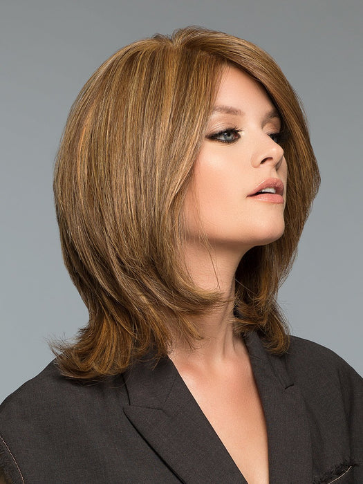 The Tiffany Hand-Tied Wig by Wig Pro is a straight layered look with soft bangs suitable for any occasion