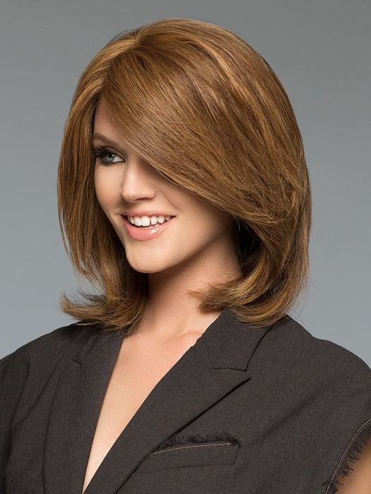 Tiffany is a medium length shag cut, showing off subtle volume and side swept bangs that accent the face