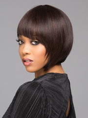 Angled bang and chin length layers frame the face with a modern twist | Color: FS1B/33