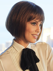 Chin-length bob with a soft wispy fringe and a stunner that is polished enough for any occasion