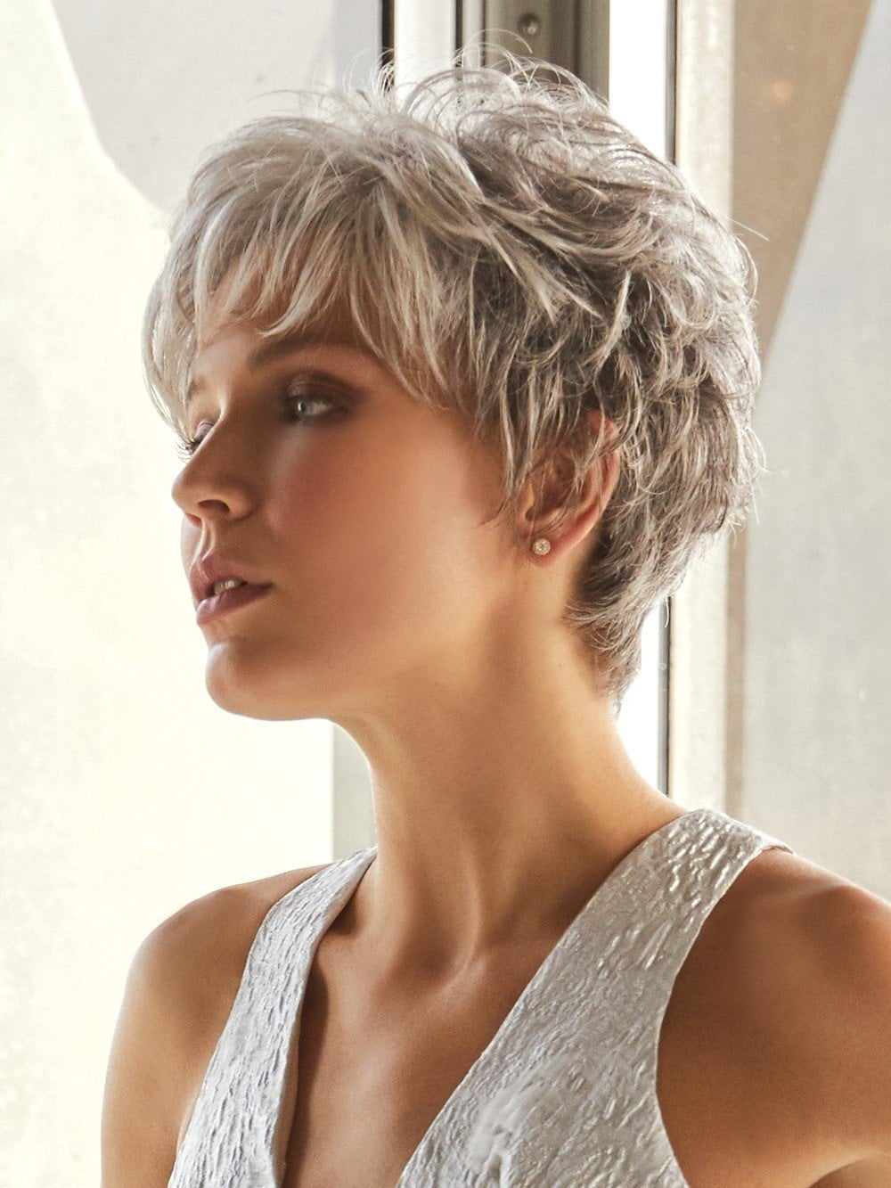 This soft layered short pixie can be brushed over the top to create a touch of height.