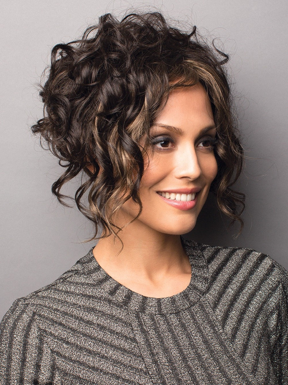 A bold A-Line cut with sexy loose curls to  frame the face.