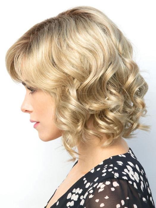 The Reign Wig by Amore is a short layered bob with tousled waves and a side-swept fringe