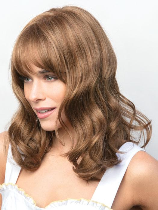 Flirty style falls below the shoulder and has soft beach waves featuring a full fringe framing the eyes