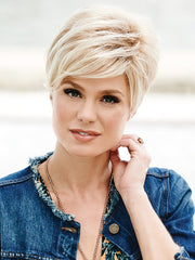 "This short basic wig style is composed of tousled waves for a fresh, ""lived-in"" look"