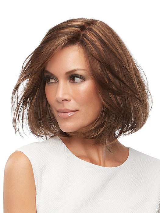 The monofilament top is hand-tied and creates multi-directional parting while providing the appearance of natural growth. This long bob is flattering for all ages and all face shapes
