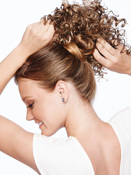 Pull your hair up in a bun, pull the drawstring tight for secure attachment