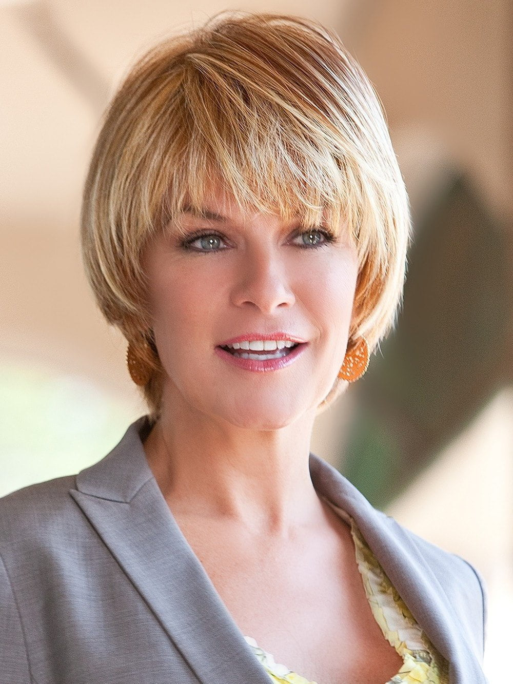 A casual short and flirty wig with straight layers for a timeless style